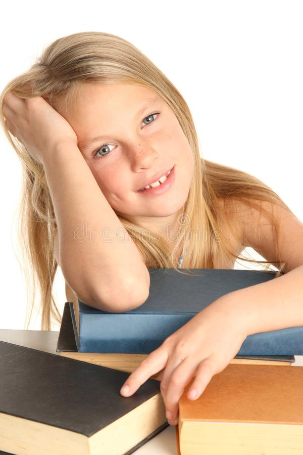 Lovely Young Kid and Books stock photography
