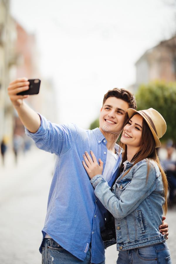 Lovely young tourist couple taking selfie phone on phone for memory spending time together at summer vocation. Discover new destin royalty free stock photos