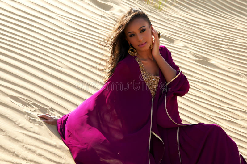 Lovely young woman in arabic desert stock images