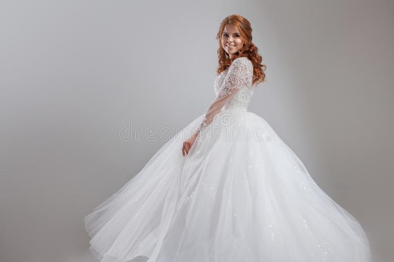 Lovely Young Woman Bride In Lavish Wedding Dress. Light Background ...