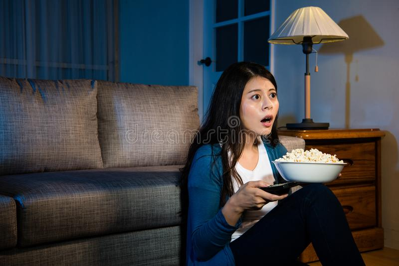 Lovely young woman holding popcorn snack stock photography
