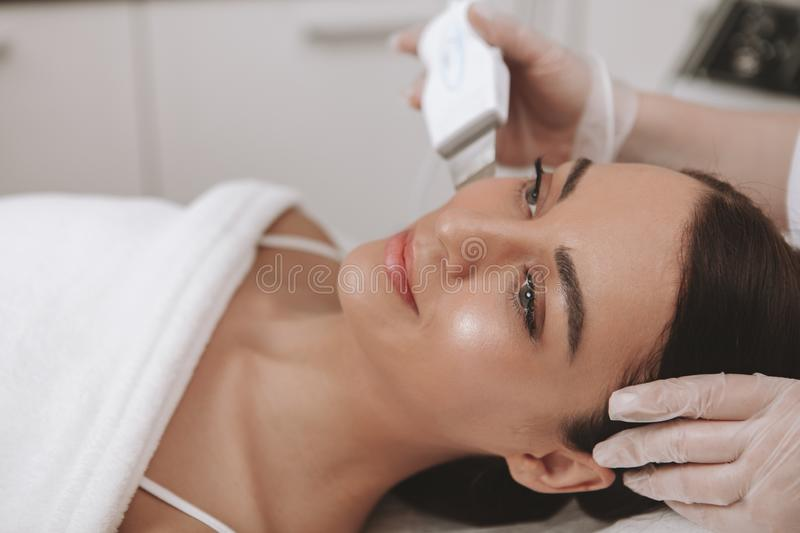 Lovely young woman visiting cosmetologist at beauty clinic stock photos