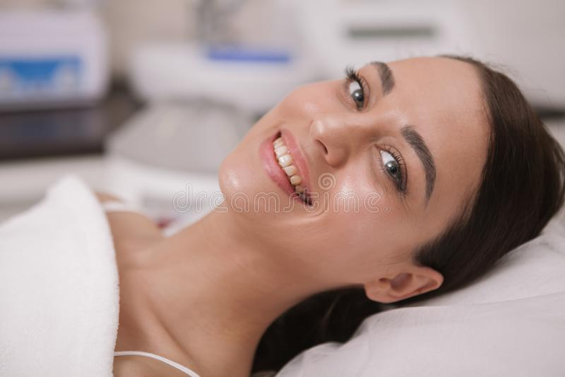 Lovely young woman visiting cosmetologist at beauty clinic royalty free stock photo