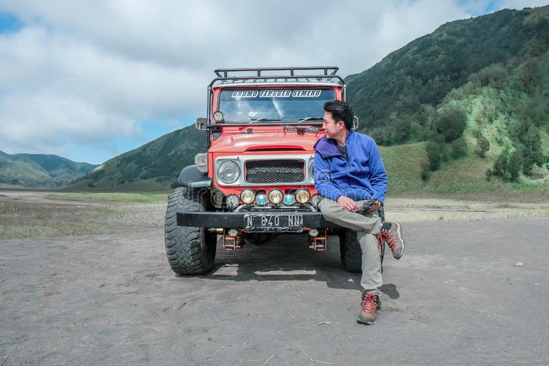 Man with red 4x4 car stock photography