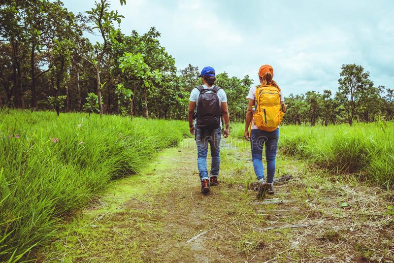 Lover woman and men Asian travel nature. Travel relax. Walk study the path Nature in the forest. Lover women and men Asian travel nature. Travel relax. Walk royalty free stock photos