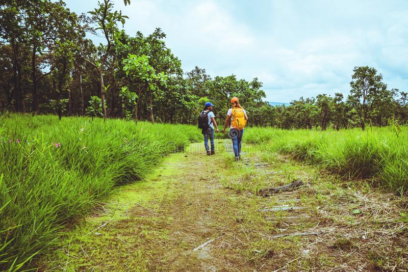 Lover woman and men Asian travel nature. Travel relax. Walk study the path Nature in the forest. Lover women and men Asian travel nature. Travel relax. Walk royalty free stock photo