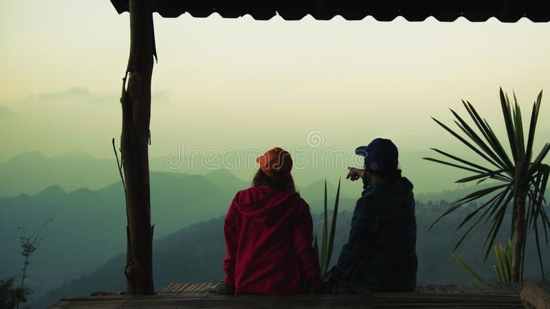 Lover women and men asians travel relax camping in the holiday. On the Moutain.Thailand. Lover women and men asians travel relax camping in the holiday. On the stock photo