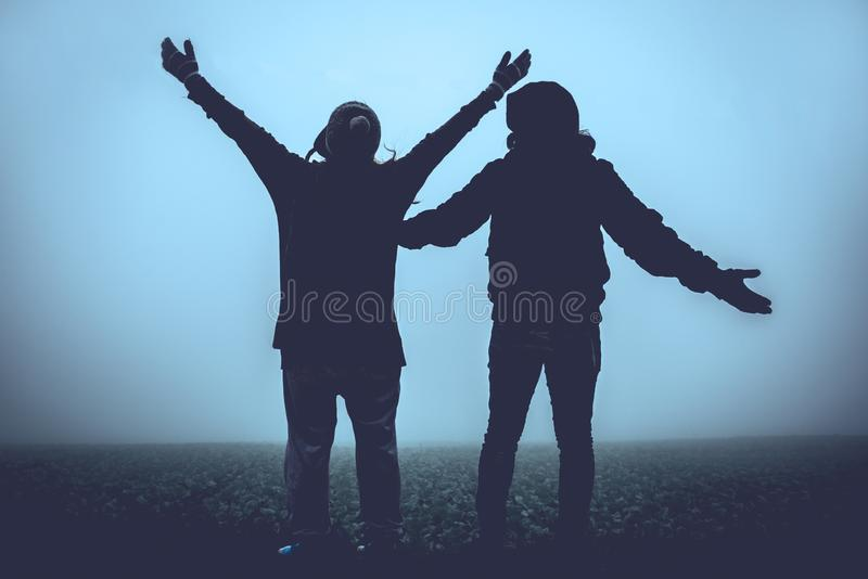 Lover women and men asians travel relax in the holiday. Happy to travel in the holiday. During the foggy winter.  royalty free stock images