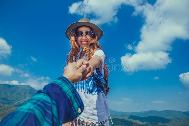 Lover women and men asians travel relax in the holiday. Lovers walk hand in hand nature on the Moutain. Thailand. Lover women and men asians travel relax in the royalty free stock images