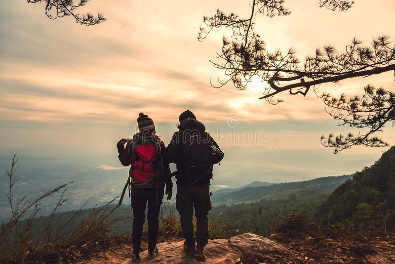 Lover women and men asians travel relax in the holiday. Photograph mountain landscapes atmosphere in the morning. In the winter. Travel backpack royalty free stock photos
