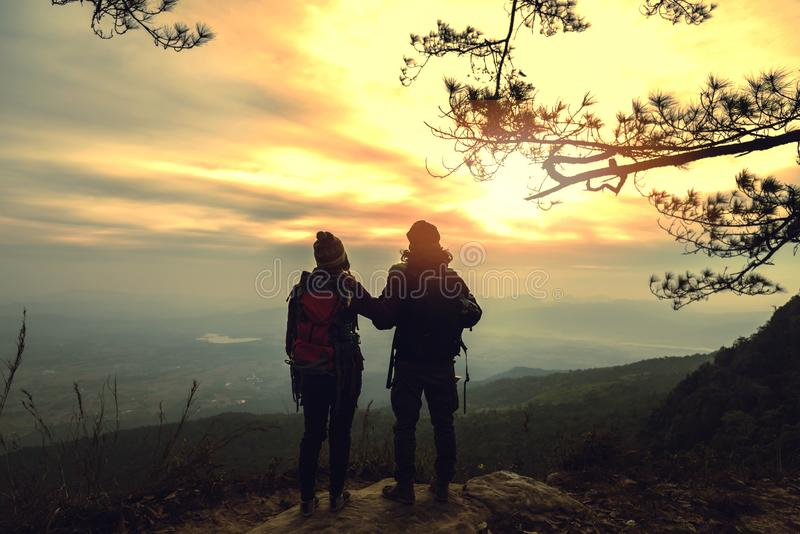 Lover women and men asians travel relax in the holiday. Photograph mountain landscapes atmosphere in the morning. In the winter. Outdoor stock photo