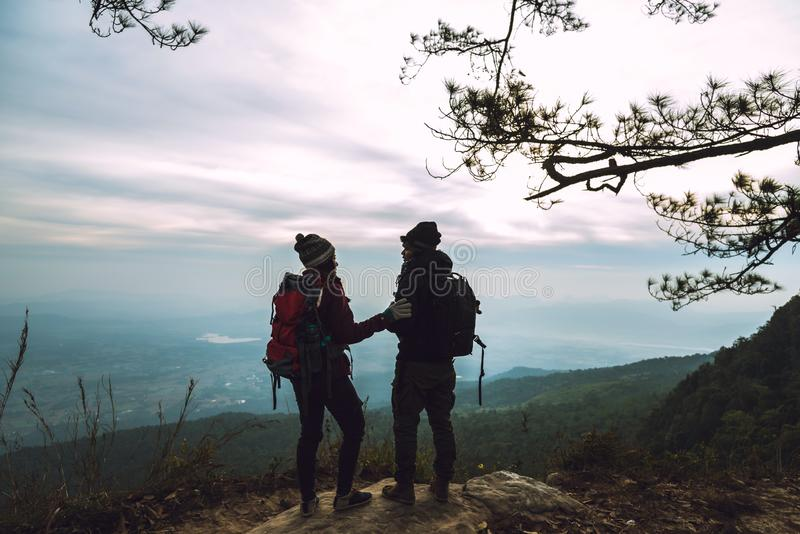 Lover women and men asians travel relax in the holiday. Photograph mountain landscapes atmosphere in the morning. In the winter. Outdoor royalty free stock images