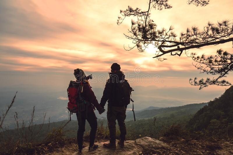 Lover women and men asians travel relax in the holiday. Photograph mountain landscapes atmosphere in the morning. In the winter. Outdoor stock photography
