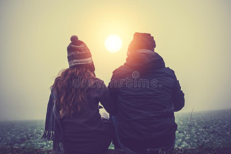 Lover women and men asians travel relax in the holiday. sit. Hug get cold in the morning on the Mountain. summer royalty free stock photos