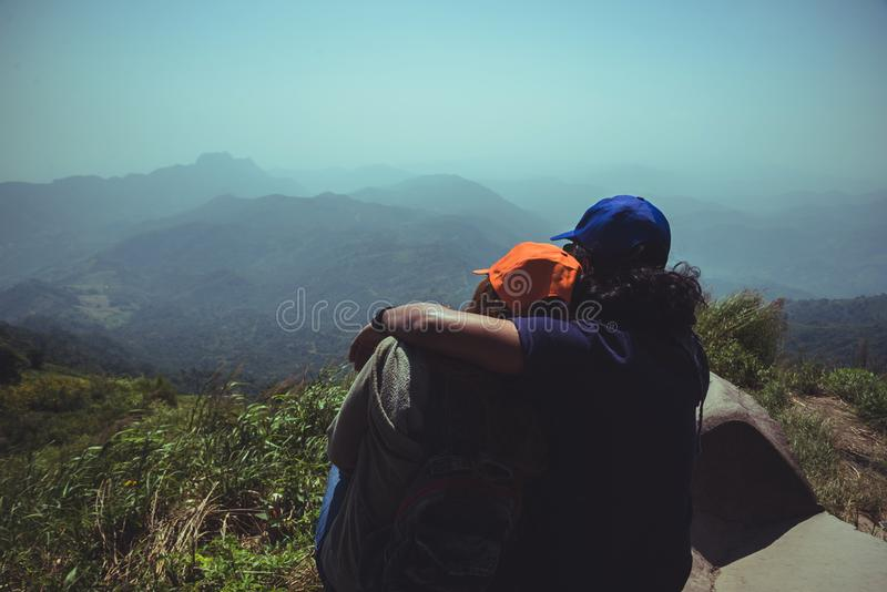Lover women and men asians travel relax in the holiday. Watch the beauty wild nature wood on the mountain.  stock photo