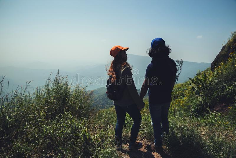 Lover women and men asians travel relax in the holiday. Watch the beauty wild nature wood on the mountain.  royalty free stock images