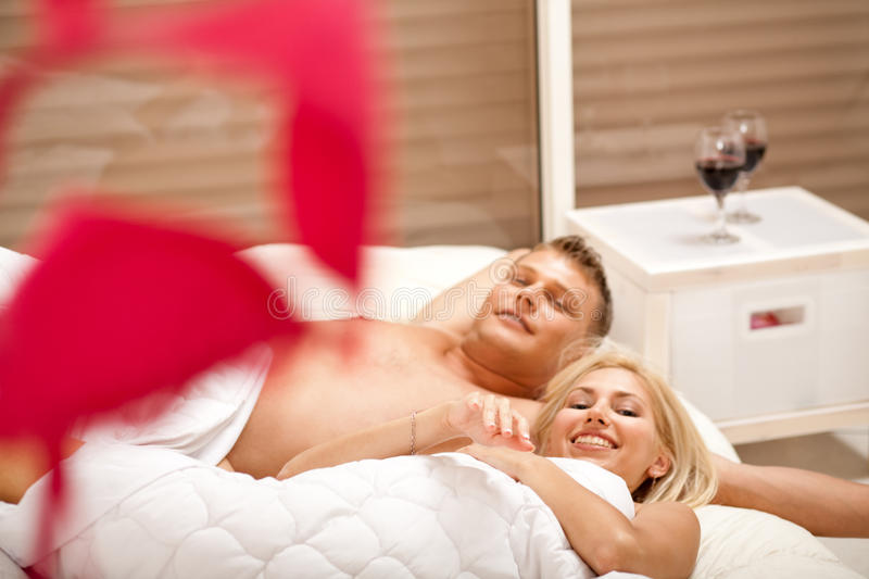Download Lovers In Bed Smiling To Camera Stock Photo - Image: 10410480