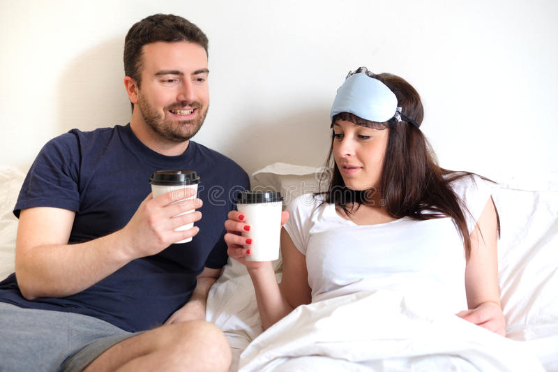 Lovers couple drinking coffee in the morning royalty free stock photo