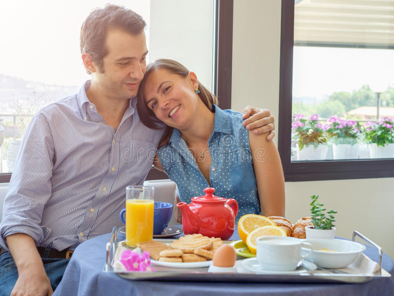 Lovers couple having breakfast in hotel royalty free stock image