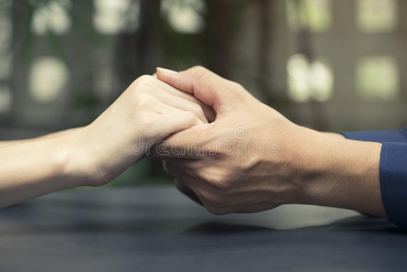 Lovers couple holding hands, love and romance concept stock images