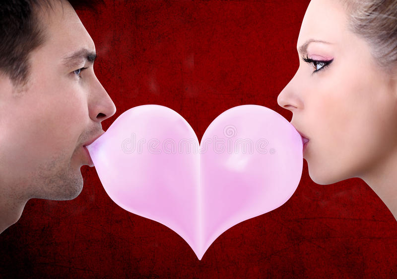 Lovers couple kiss heart shaped valentine day with chewing gum. On red background stock photos