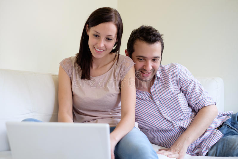 Lovers couple with notebook stock images