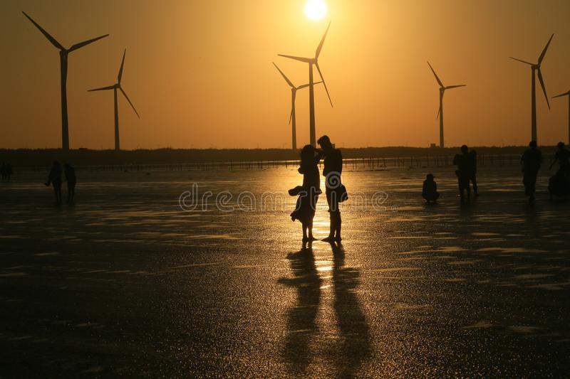Lovers Enjoy Their Time at Sunset royalty free stock photography
