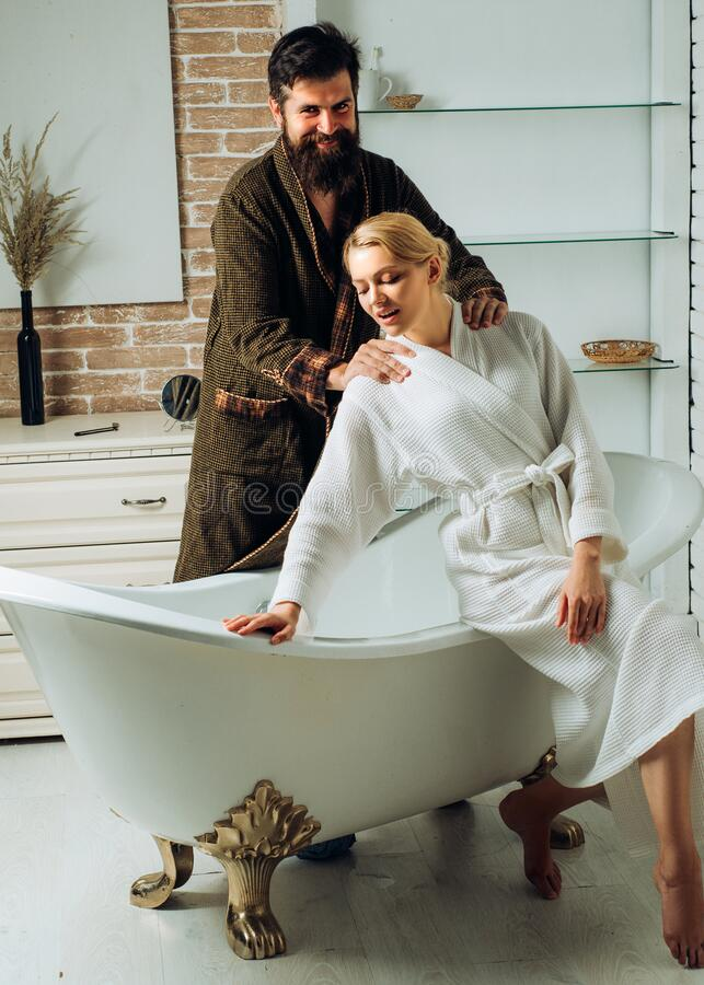 Lovers are fooling around. Everyday life. Morning hygiene. Relaxing time. Young adult body care morning routine. Morning. Morning sexy couple. Happy young royalty free stock photography