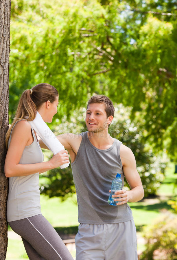Lovers after the gym. Having a rest stock photo