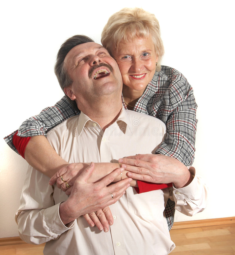 Lovers at home. Happy old couple at home with copyspace royalty free stock photo