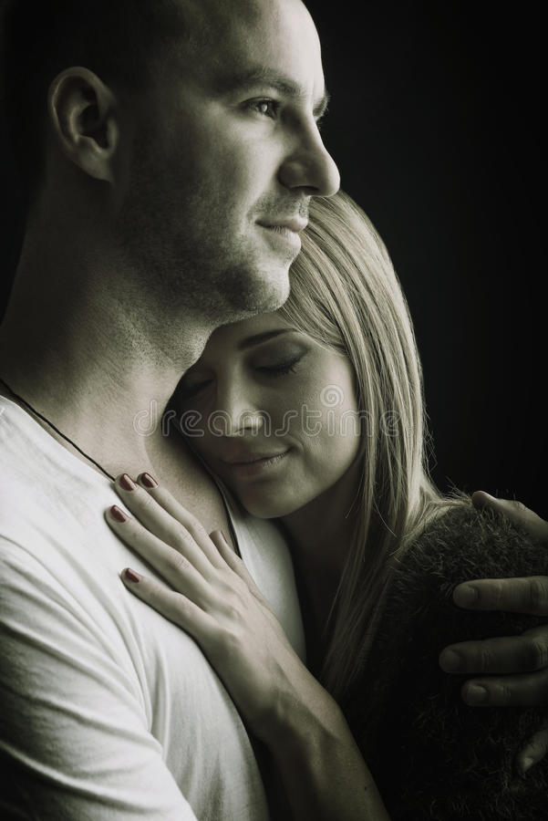 Download lovers hug safety black and white photo stock photo image of gray