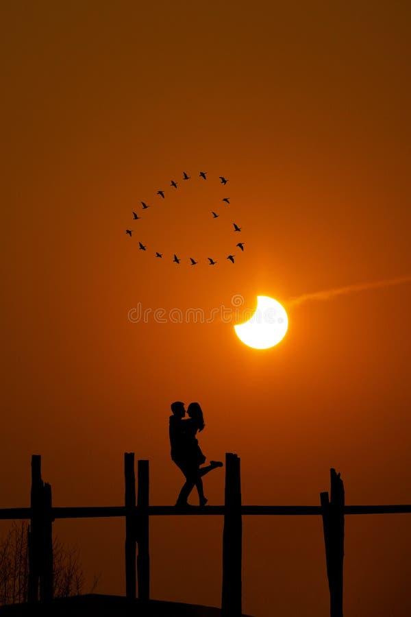 Free Lovers Hugging On U Bein Bridge, Myanmar Stock Photos - 212424133