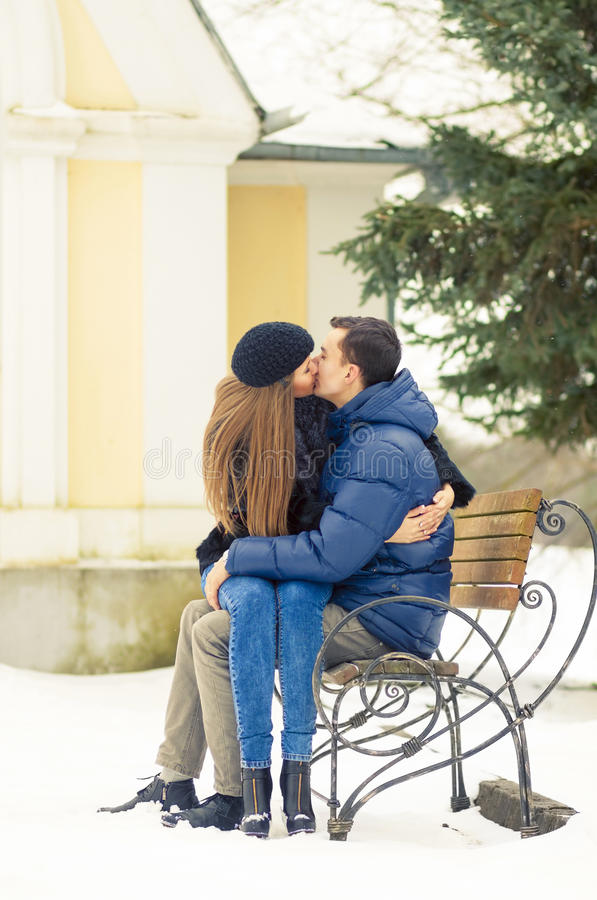 Lovers Kissing On The Bench Stock Photo