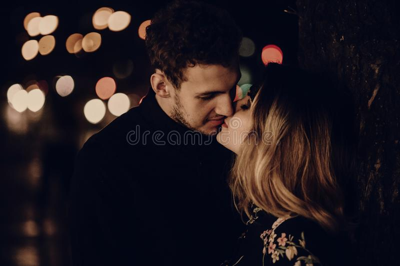 Lovers kissing at night, sensual couple portait face close-up, h stock photo
