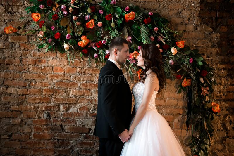 Lovers looking at each other holding hands royalty free stock image