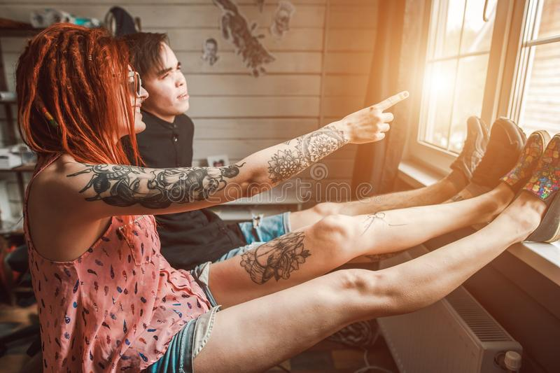 Lovers man and woman look out the window royalty free stock photography