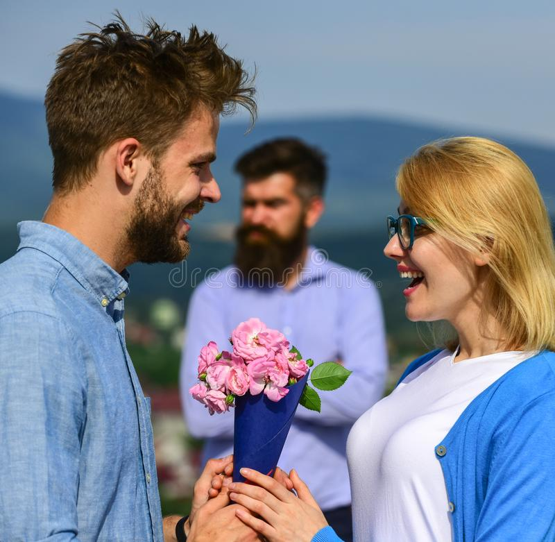 Lovers meeting outdoor flirt romance relations. Couple in love dating while jealous husband fixedly watching on royalty free stock photos