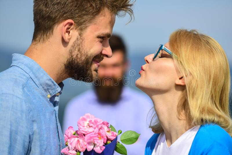 Lovers meeting outdoor flirt romance relations. Couple romantic date lover present bouquet flowers. Unrequited love stock image