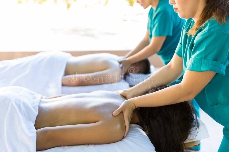 Lovers Receiving Back Massage At Dayspa royalty free stock photo
