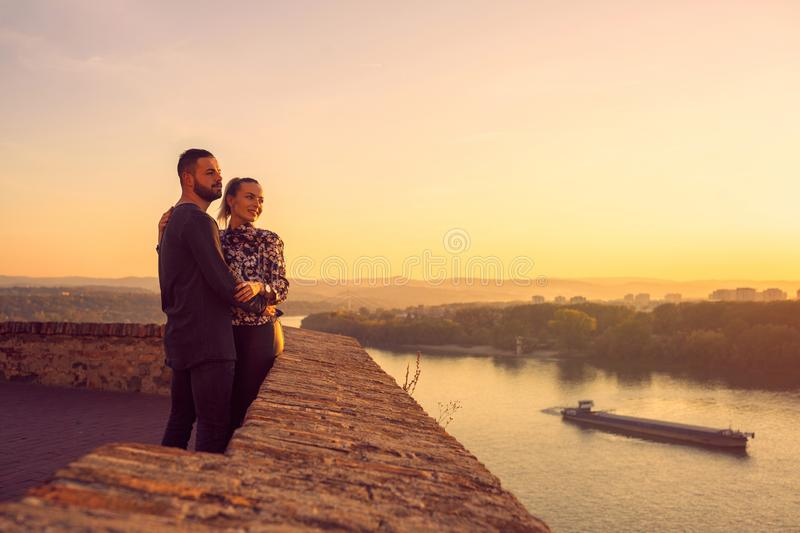 Lovers. romantic at sunset. Couple smiling and enjoying together stock images
