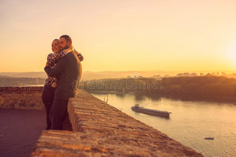 Lovers. romantic at sunset. Man and woman enjoying together royalty free stock image