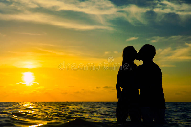 Lovers at sunset royalty free stock images