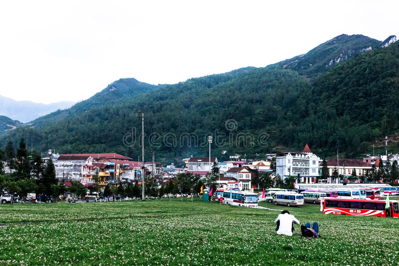 Lovers take a rest with a beatiful landscape view. Grass hill in Sapa, Vietname for take a rest stock photo