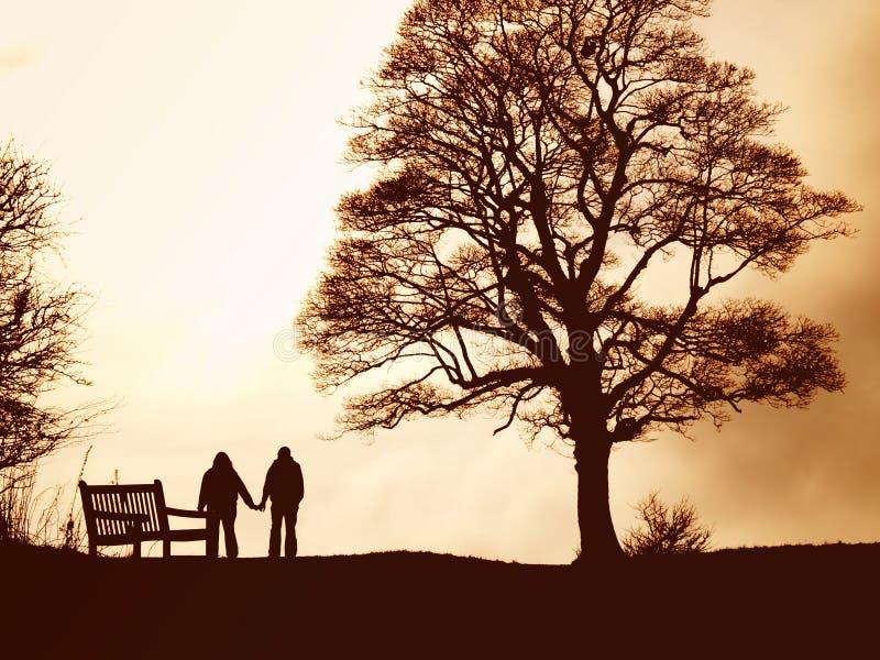 Lovers Walk. A couple enjoy a romantic walk at sunset
