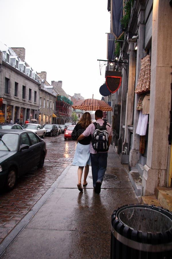 Lovers Walking Down Rainy Street royalty free stock photo