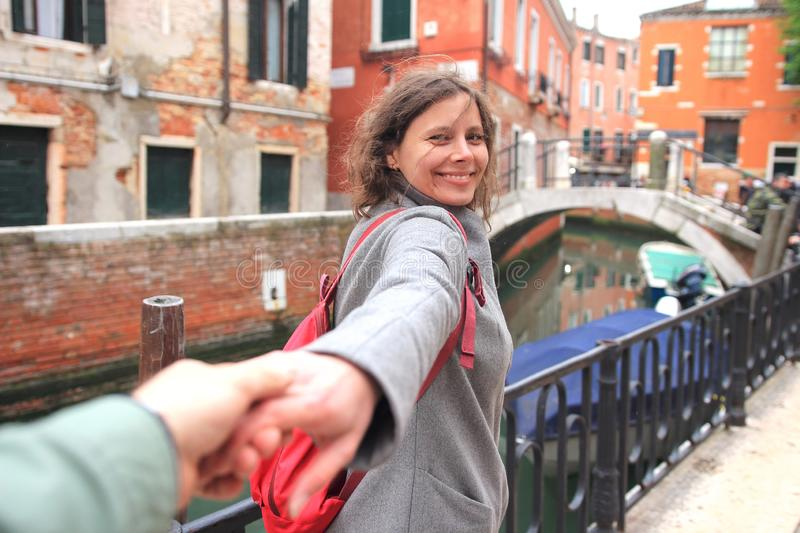 Lovers walking on Venice streets. Happy romantic vacation in Italy. Couple enjoying in Venice royalty free stock image