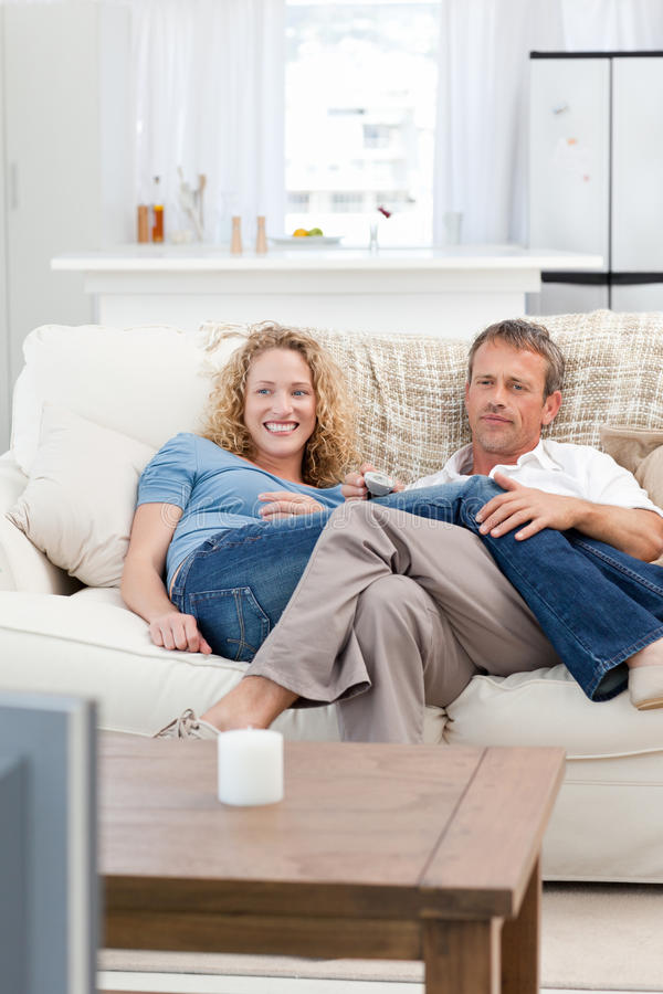 Download Lovers Watching Tv In The Living Room Royalty Free Stock Images - Image: 18106929