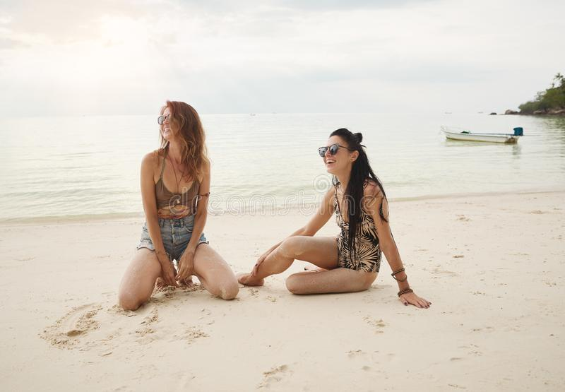 Lovers young couple of girls. On the beach . Concept of LGBT royalty free stock photography