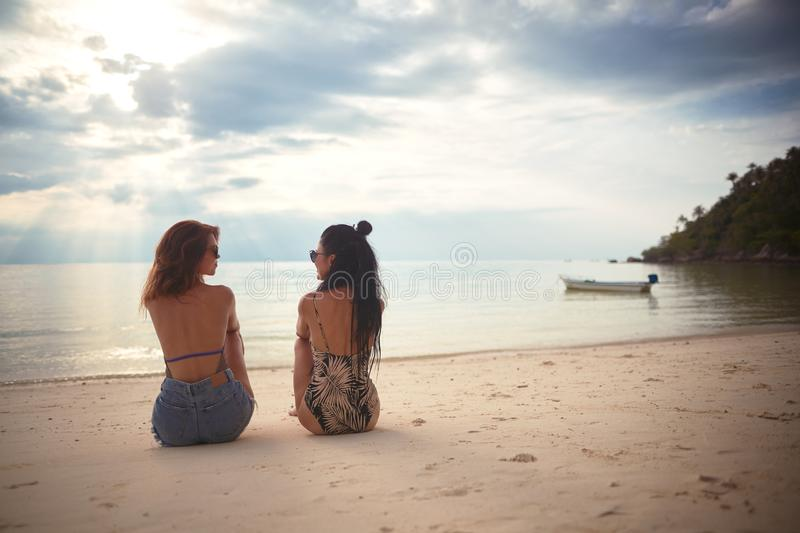 Lovers young couple of girls. On the beach . Concept of LGBT royalty free stock image