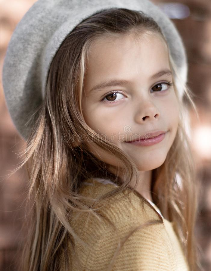 She loves the look of autumn. Little girl outdoor royalty free stock images